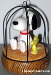 Snoopy on tree swing with Woodstock Musicbox