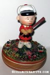Charlie Brown standing on pitcher's mound with baseball bat Musical