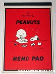 Charlie Brown writing Letter with Snoopy looking on Memo Pad