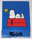 Snoopy on doghouse with Woodstock notebook