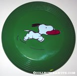 Snoopy running with toy Plastic Flying Disc