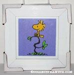 Woodstock sitting on tree Framed Print