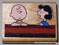 Lucy & Charlie Brown talking at wall Rubber Stamp