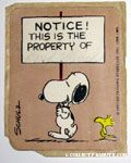 Snoopy carrying sign