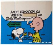 Snoopy giving Charlie Brown cake