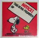 Snoopy and Woodstock with Sign