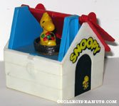 Woodstock holding flower in Dog House Toy