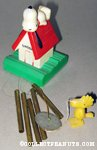 Snoopy on doghouse with Woodstock Windchime