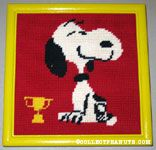 Snoopy sitting with trophy Stitchery Picture