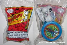 Snoopy riding on wheel toy Snoopy & the Peanuts Gang Series