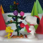 Snoopy and Woodstock singing Christmas carols.