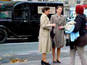 Shooting a movie in Paris-Place Monge-extras receiving instructions