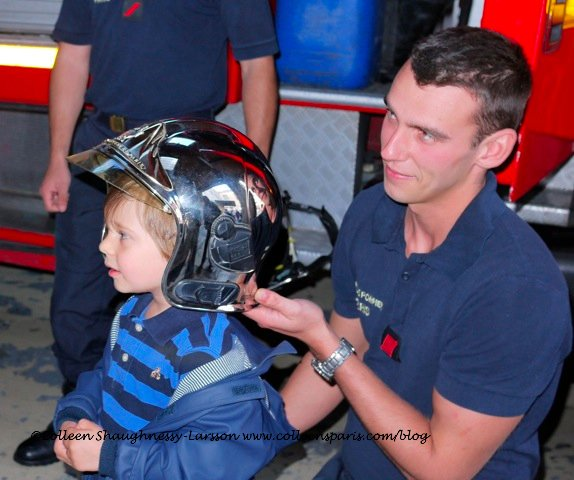 Sapeur Pompier demonstrating helmet on future rescuer recruit