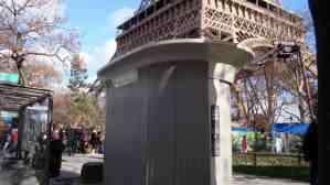 Paris sanisette with familar Eiffel Tower background