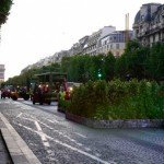 Small trucks setting up Nature Capitale along Champs Elysees