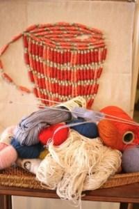 Needlework decoration of bobbins, knitting needles, yarn, Au ver à soie, Paris®