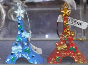Paris Christmas Eiffel Tower decorations looking at me through a store window