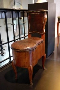 Oak and leather bidet signed Simon Oeben (d. 1786) France from the Château de Chanteloup and belonged to the Duke of Penthièvre; legs signed Margaret Blake-Gould, 1933
