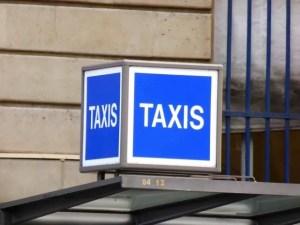 The blue taxi waiting stand across from BHV (Bazaar de l'Hotel de Ville) and the Mairie de Paris, rue de Lobau