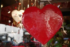 Red heart for St. Valentine's day hanging in florist window