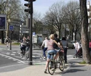 Bikes crosing street at bike crosswalk in Paris near Bastille and Canal Saint Martin
