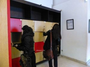 Two girls at Musée Carnavalet using the small lockers next to coat check. Deposit a coin, close, take the key and your money will be returned when you reopen the locker