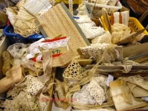 Bundles of old lace ribbon at Emmaeus stand Aiguille en Fete