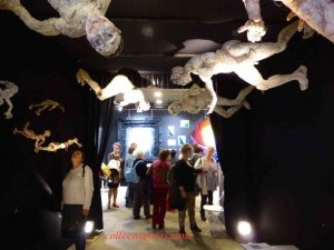 Fabric sculptures suspended from ceiling and walls in exposition hall Aiguille en Fete