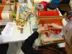 Woman working loom Aiguille en Fete