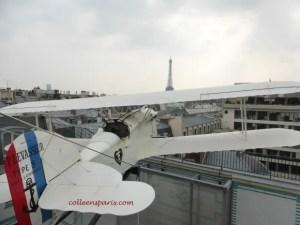 L'Oiseau Blanc biplane heading toward the Eiffel Tower