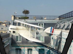 Close quarters as the l'Oiseau Blanc biplane flies out of the courtyard of the Peninsual Hotel