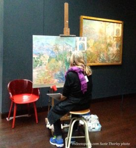 Artist at easel as in former days at museum, replicating a famous painting