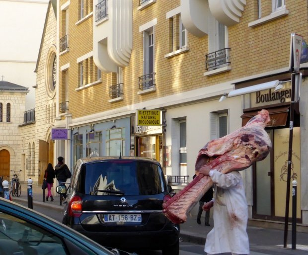 Butcher carrying hunk of meat Something always going on in Paris. Rue Lormel 15th