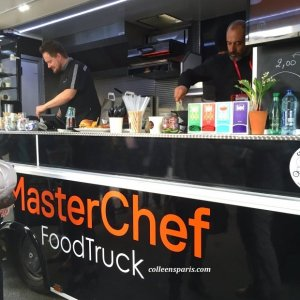 Master Chef's truck with example of burger plate and two chefs