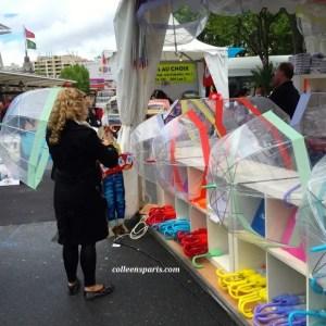 Sometimes the rain wants to participate at the Foire de Paris. Stand selling umbrellas