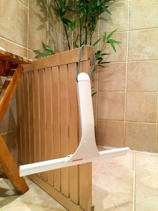 shower/window/wall wiper hanging on wood mat in shower