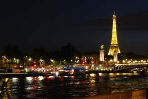Eiffel Tower as a backdrop to Pont Alexandre III on a Paris photo night walk capturing movement