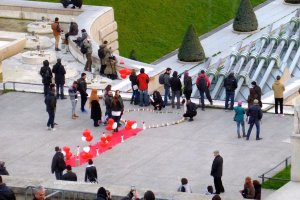 Lighting candles in the shape of a heart. View from Musee de l'Homme Chaillot Trocadéro
