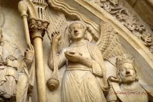Angel holding a 13th century censer with triple chains, Notre-Dame de Paris