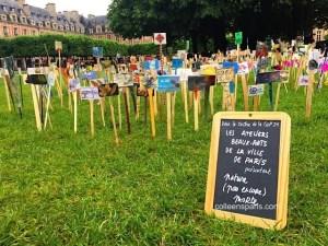 Place des Vosges lawn with art work on COP21 theme from Ateliers Beaux Arts, Ville de Paris art courses