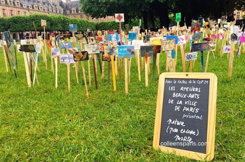 Place des Vosges lawn with art work on COP21 theme from Ateliers Beaux Arts, Ville de Paris art courses