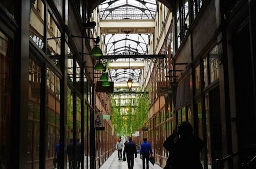 Looking skyward in the Passage du Grand Cerf between rue Saint-Denis and Place Goldoni in the Bonne Nouvelle neighborhood, Paris