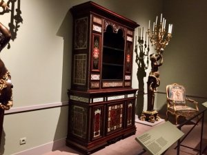 Home furnishings a chest and floor standing candelabra