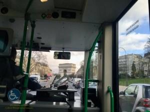 Inside shuttle along Avenue Foch toward Arc de Triomphe