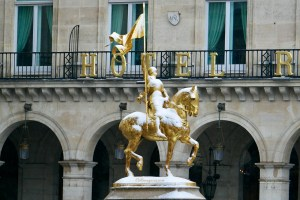 A Snow Day in Paris Statue of Jeanne d'Arc with powdered snow