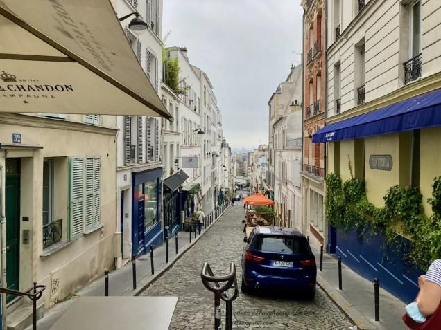 Looking down rue Thorlozé Montmartre Le Moulin de la Galette behind