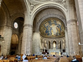 Interior of Sacre Coeur with a few worshipers Thursday morning