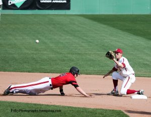 Friday April 22, 2016 Chestnut Hill, Massachusetts; Louisville pitcher Brendan McKay (38) dives back to second base with Boston College infielder Johnny Adams (8) in position for a pickoff throw during a game between the Boston College Eagles and the Louisville Cardinals. BC won the game 6-1 at Shea Field.