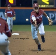 Duke Kinamon underhands the ball to Winaker at first. - Photo By David Cohen, BHEphotos