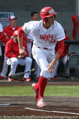 Monday, March 20, 2017; Northboro, MA; WPI Engineers third baseman Steven Gallagher (14) watches his hit during the Engineers come from behind 9-7 victory over the Scots at the New England Baseball Complex.